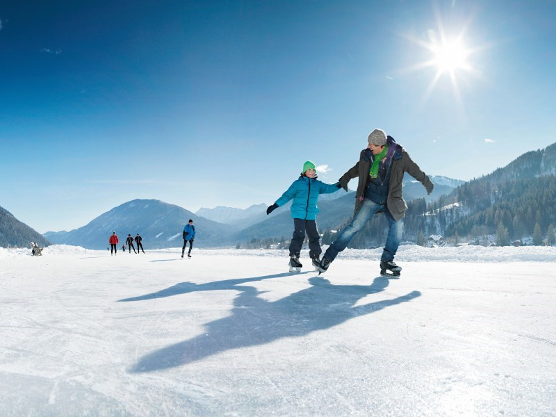 Ice skating on the ice of Lake Weissensee