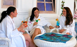 Ladies in bathrobes enjoy their drinks - relaxing in the spa