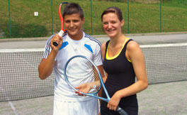 Two tennis player with tennis rackets at the tennis courts from Hotel Glocknerhof in Kärnten